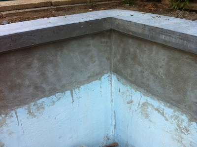 parging over pool tile area