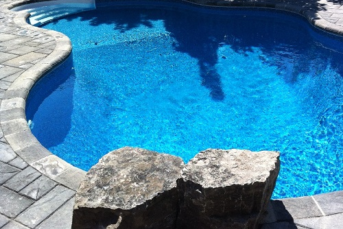 Stone coping on a vinyl liner pool